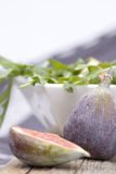 Figs with rocket salad Stock Photos