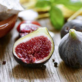 Figs on a rustic wooden table Stock Photo