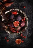 Figs in the silver plate. With raspberries Stock Photo