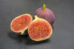 Figs on slate plate Royalty Free Stock Photography