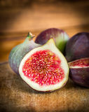 Figs Slice in light on dark wooden background Stock Images