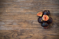 Figs sliced  on wooden table Royalty Free Stock Images