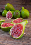 Figs sliced  on wooden table Royalty Free Stock Image