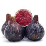 Figs. Some figs, one of them cut in halves, on a white background Stock Images