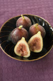 Figs still life. Still life three whole figs and one sliced in a japanese bowel Royalty Free Stock Photos