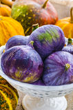 Figs in a vintage vase. On a background of pumpkin Royalty Free Stock Image