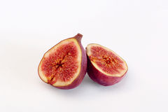Figs on a white background , juicy and ripe. A ripe and juicy purple cut and be on a white background Royalty Free Stock Photos