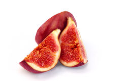 Figs on a white background , juicy and ripe. A ripe and juicy purple cut and be on a white background Royalty Free Stock Photography