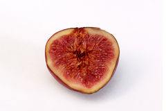 Figs on a white background , juicy and ripe. A ripe and juicy purple cut and be on a white background Royalty Free Stock Images