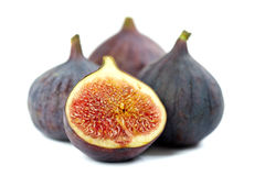 Figs on white background. Whole and two half figs  on white Stock Photo