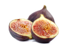 Figs on white background. Whole and two half figs isolated on white Stock Photography