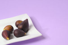Figs on white plate Stock Photos