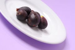 Figs on white plate Royalty Free Stock Photos