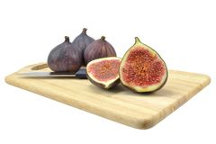 Figs on wooden board Royalty Free Stock Photography