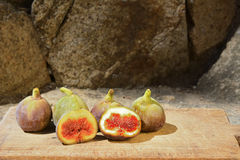 Figs on a wooden board. Royalty Free Stock Photo