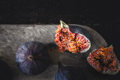 Figs on the wooden board horizontal Royalty Free Stock Photos