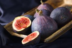Figs in wooden bowl Royalty Free Stock Photography