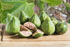 Figs on a wooden cutting board, great Italian appetizer royalty free stock photo