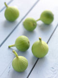 Figs on a wooden surface Royalty Free Stock Images