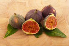 Figs on wooden timber Stock Images