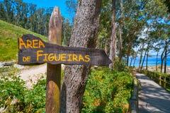Figueiras nudist beach road sign in Islas Cies island. Of Vigo Spain stock images