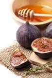 Figues et miel Photographie stock