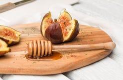 Figues et miel images stock