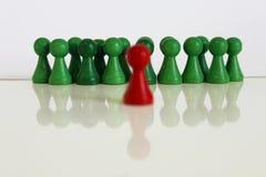 Figura única objeto principal verde rojo del equipo del jefe Imagen de archivo libre de regalías