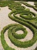 Figura abstracta en un jardín Fotos de archivo libres de regalías