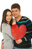 Figura amorosa del cuore della holding delle coppie Immagine Stock