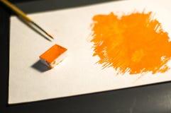 Figura arancio dipinta con l'acquerello immagini stock libere da diritti