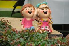 Figura benvenuta piacevole in giardino tropicale asiatico Fotografia Stock