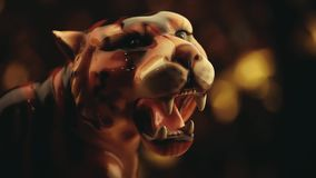 Figura bokeh della tigre dell'oro stock footage