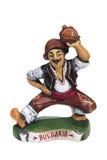 Figura ceramica dell'uomo bulgaro tradizionale, isolata Immagini Stock
