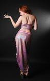 Figura cesellata della ragazza in uno splendere del vestito Immagine Stock