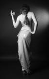Figura cesellata della ragazza in vestito brillante, retrovisione Fotografie Stock Libere da Diritti