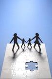 Figura da família na placa do enigma Imagem de Stock Royalty Free