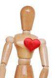 Figura de madeira com coração vermelho Fotos de Stock Royalty Free