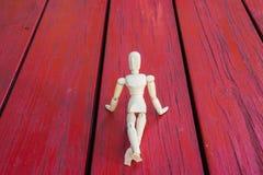 Figura de madeira mostra e presente Fotografia de Stock