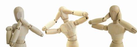 A figura de madeira nenhuma considera que para falar ouça o conceito da boneca imagem de stock royalty free