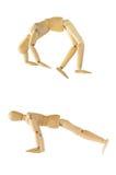 Figura de madera que muestra en la acción de salto Fotografía de archivo libre de regalías