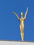 Figura de oro de una mujer Foto de archivo