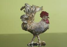 Figura de oro del gallo Imágenes de archivo libres de regalías
