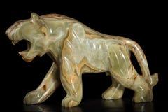Figura de pedra de um tigre Fotografia de Stock Royalty Free