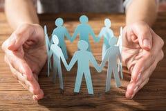 Figura de Person Protecting Paper Cut Out Imagen de archivo libre de regalías