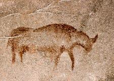 Figura de um animal do mamífero em uma caverna imagens de stock
