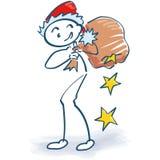 Figura del bastone come Santa Claus con la borsa dei regali Fotografie Stock Libere da Diritti