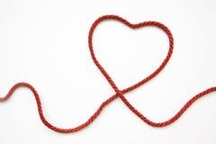 Figura del cuore fatta da cavo rosso Immagini Stock Libere da Diritti