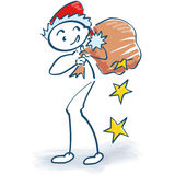 Figura del palillo como Santa Claus con el bolso de los regalos Fotos de archivo libres de regalías