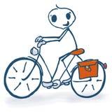 Figura del palillo con una bicicleta Imagen de archivo